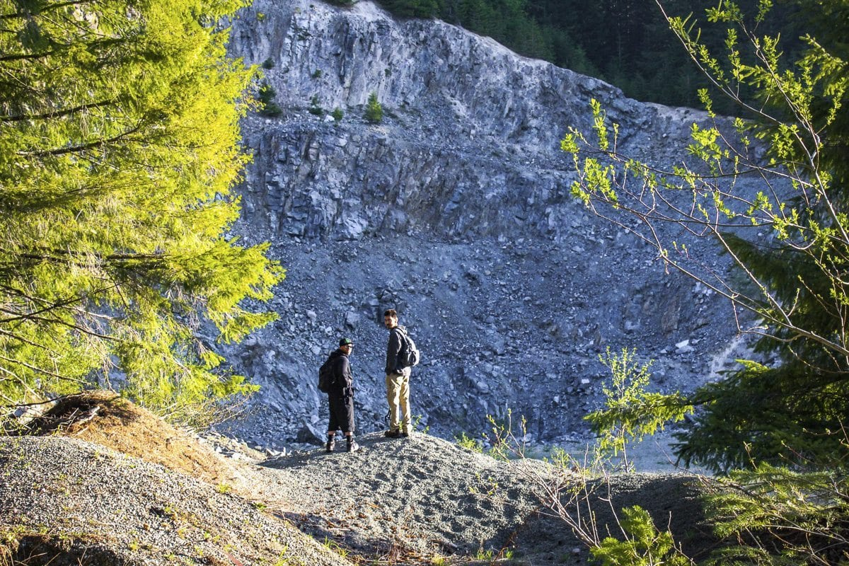 A pair of hikers take in the scenery near the start of the path to the summit. Photo by Eric Schwartz