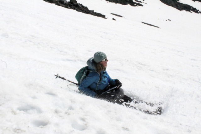 A woman glissades down Mount St. Helens Tuesday. Photo by Eric Schwartz