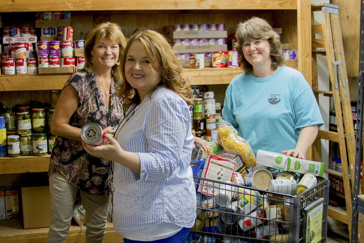 The Woodland Action Center partners with Woodland Public Schools to help provide families-in-need more access to food and resources. Pictured here (left to right) are Heidi Butler, volunteer; Julie Clark, Woodland Action Center Warehouse Coordinator; and Leslie Mohlman, Woodland School District's Community, Family, Student Resource coordinator. Photo courtesy of Woodland Public Schools