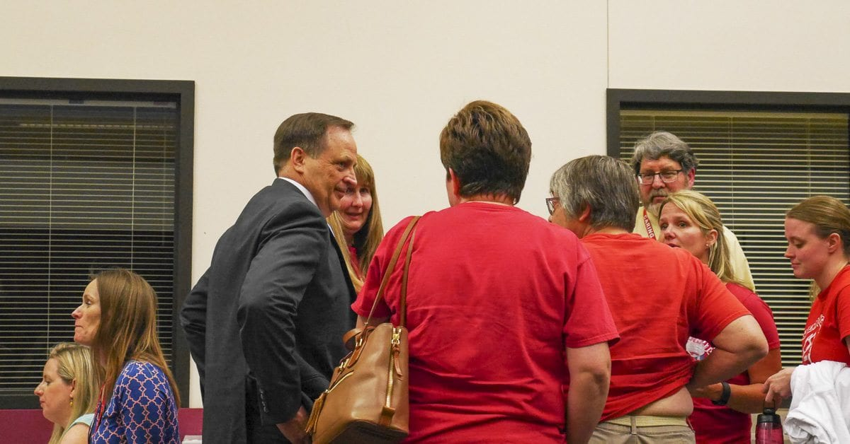 Battle Ground Schools Superintendent Mark Ross talks with Glenwood teachers during a break in Monday's meeting. Photo by Chris Brown