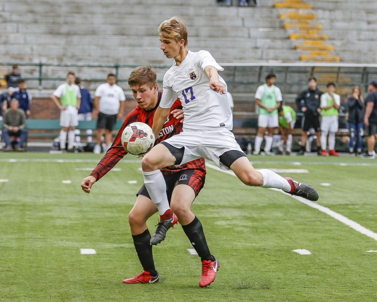 Columbia River's Jacob Warthen seems to defy gravity as he goes after the ball against Clarkston in a Class 2A state soccer playoff match Wednesday at Kiggins Bowl. Photo by Mike Schultz