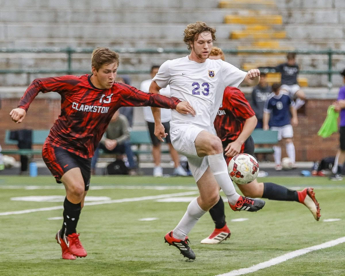 Ryan Connop, shown here battling two Clarkston players, scored the game-winning goal Wednesday night, helping Columbia River reach the Class 2A state quarterfinals. The Chieftains beat Clarkston 3-2. Photo by Mike Schultz