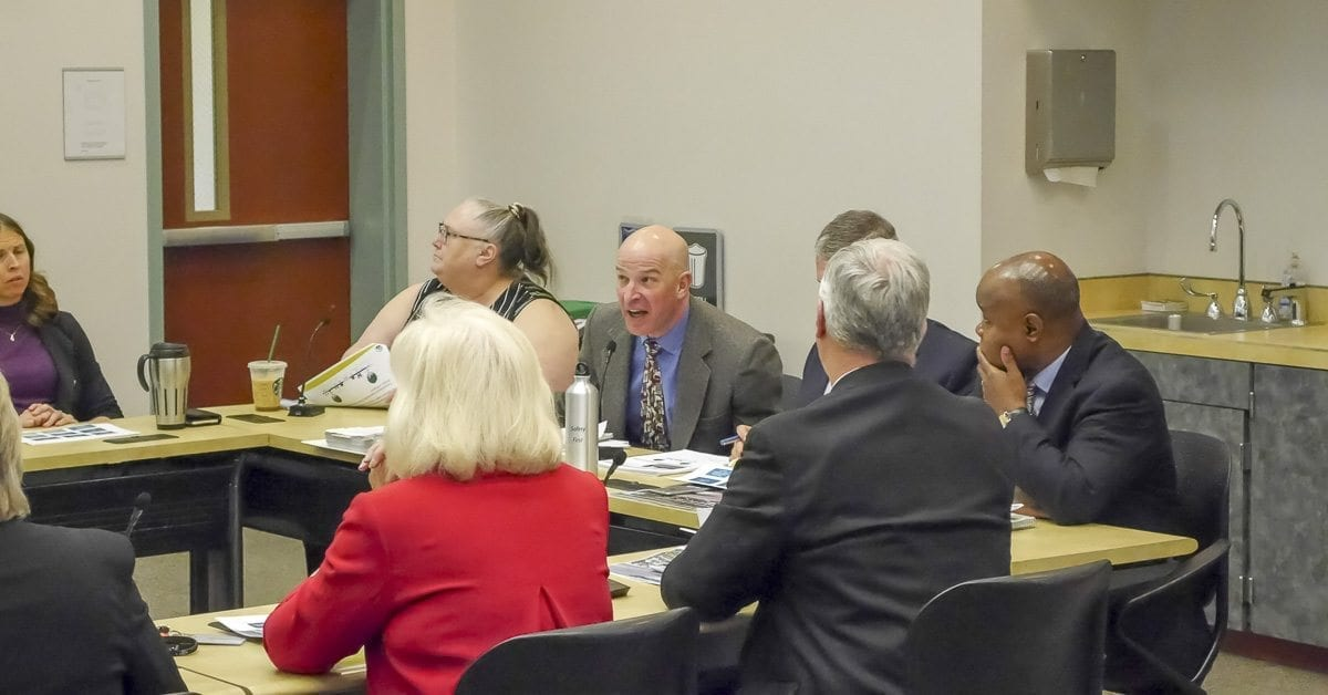 County planner Gary Albrecht (center) explains a point about the Complete Streets ordinance to county commissioners at a Wednesday work session. Photo by Chris Brown
