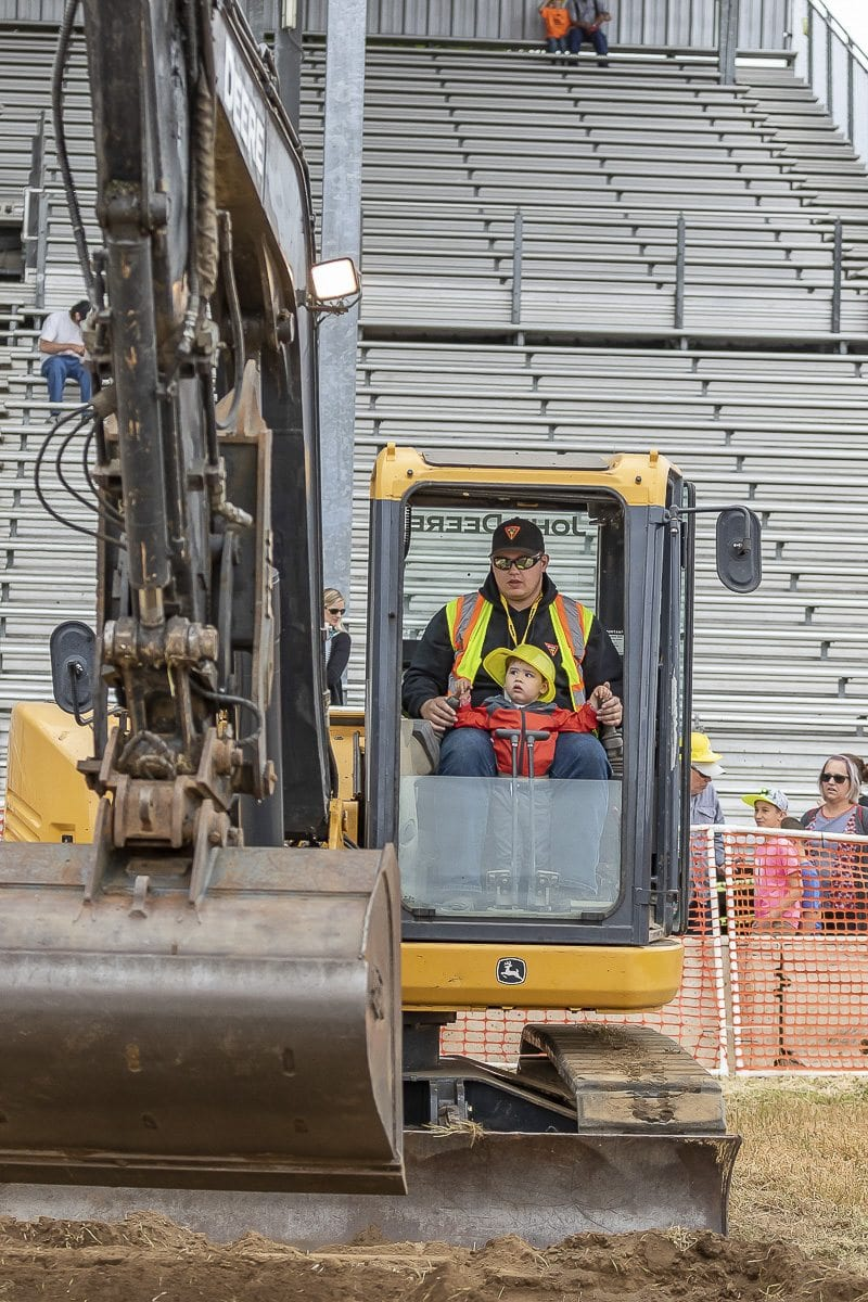 For Dozer Day, dozens of diggers, excavators, and bulldozers line the grandstand lawn, where machine operators let the young ones take the controls. Photo by Mike Schultz