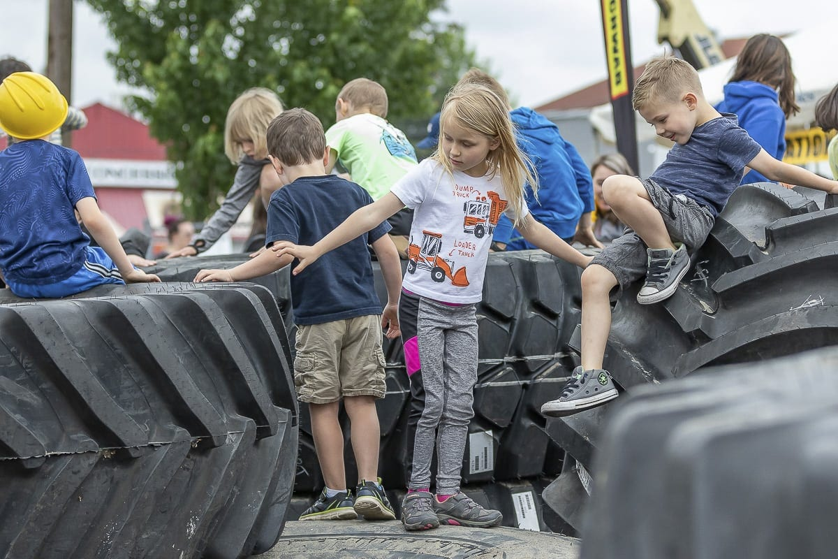 A tire crawl, with enormous tractor tires, gives kids the chance to climb, crawl, and hide to their hearts' content. Photo by Mike Schultz