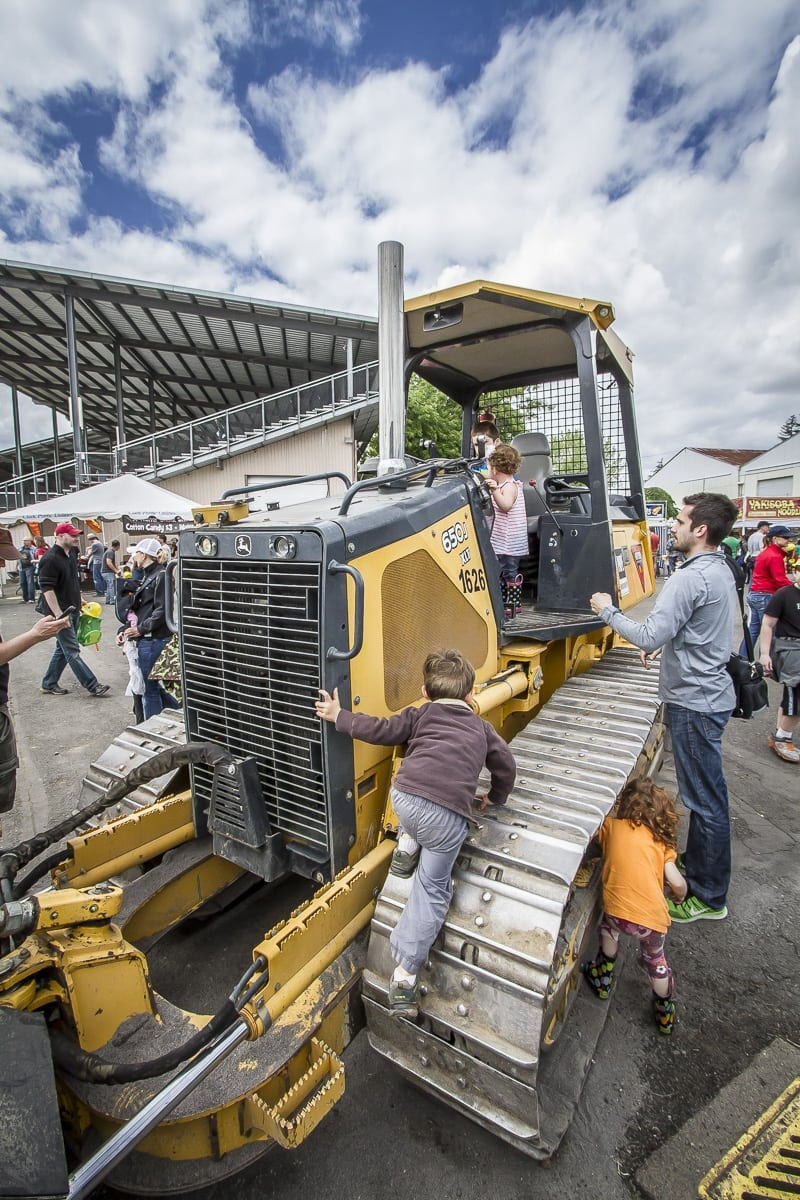 Families with children of all ages are invited to join dozens of machine operators, who will assist in teaching the children how to run the equipment at Dozer Day. Photo by Mike Schultz.