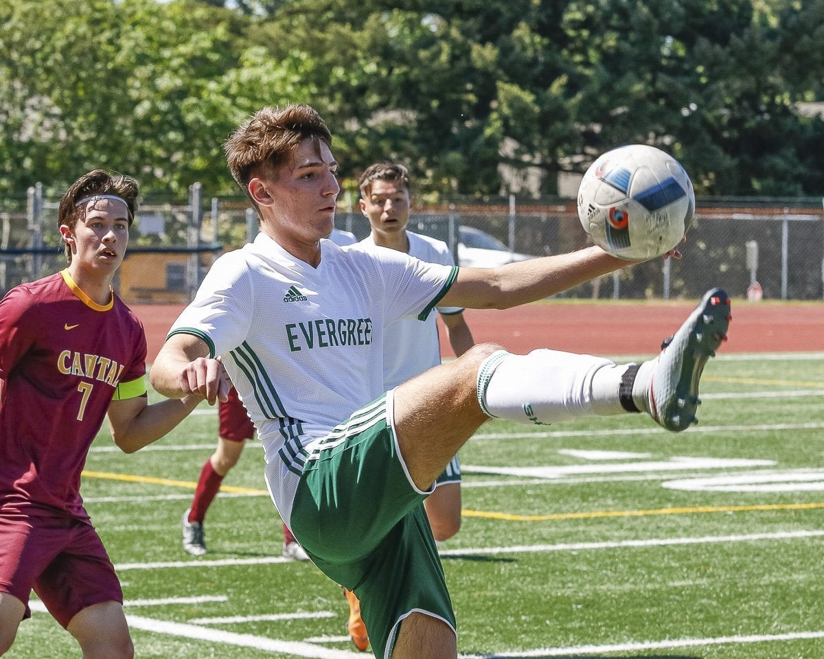 Nathan Cojocaru of Evergreen controls the ball during his team's 2-1 victory over Capital in a bi-district elimination match Saturday at McKenzie Stadium. Evergreen won the match 2-1 to qualify for state. Photo by Mike Schultz