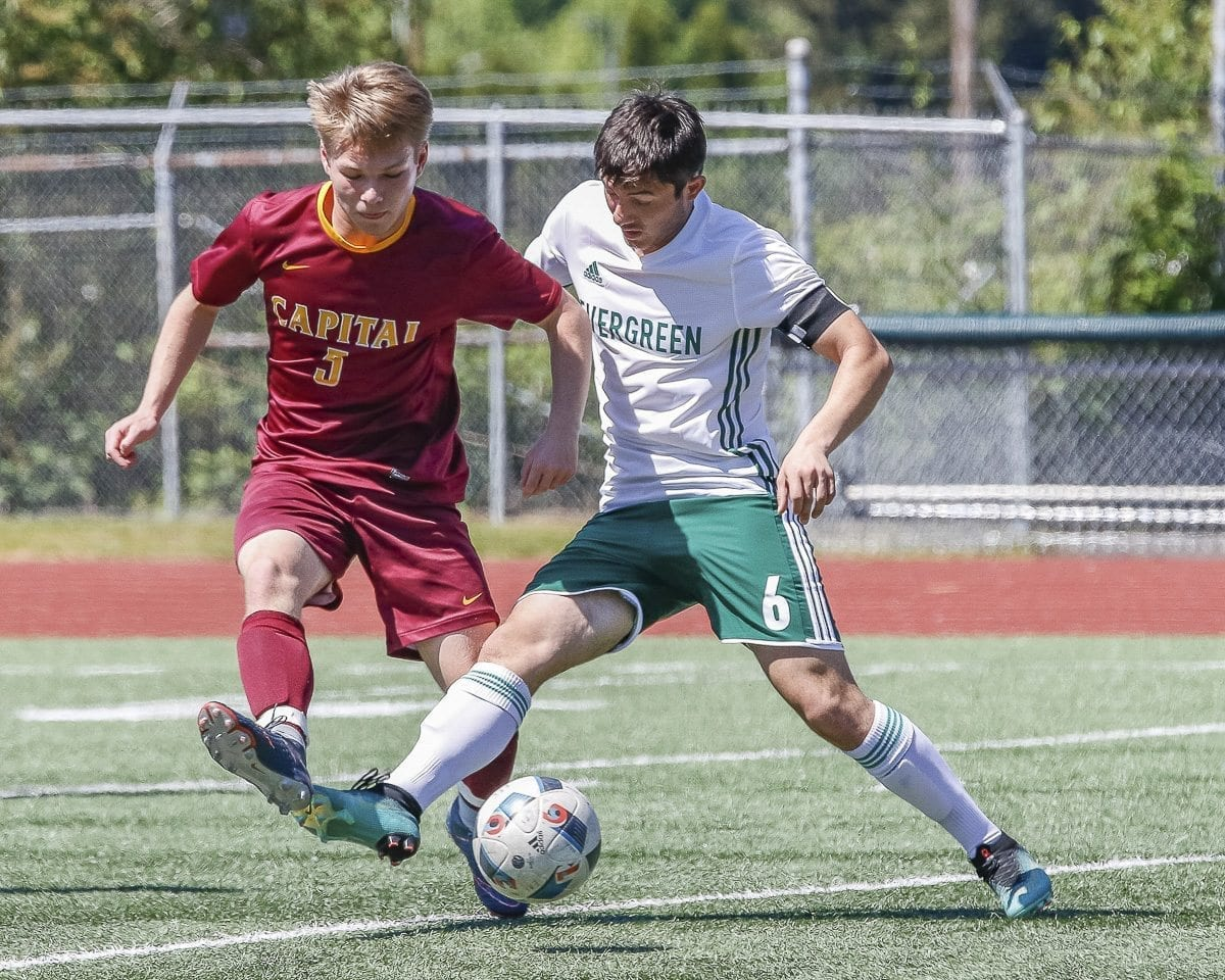 Evergreen's Levan Zhividze (6) is faster to the ball than his opponent from Capital on this play Saturday at McKenzie Stadium. Evergreen won the match to qualify for state. Photo by Mike Schultz
