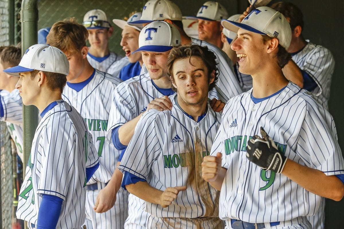 The Mountain View Thunder celebrate a big moment Saturday morning during the team's win over Yelm. Mountain View's dugout has been a constant buzz of energy throughout the season. Players and coaches say it is one of the keys to the team's success. Photo by Mike Schultz