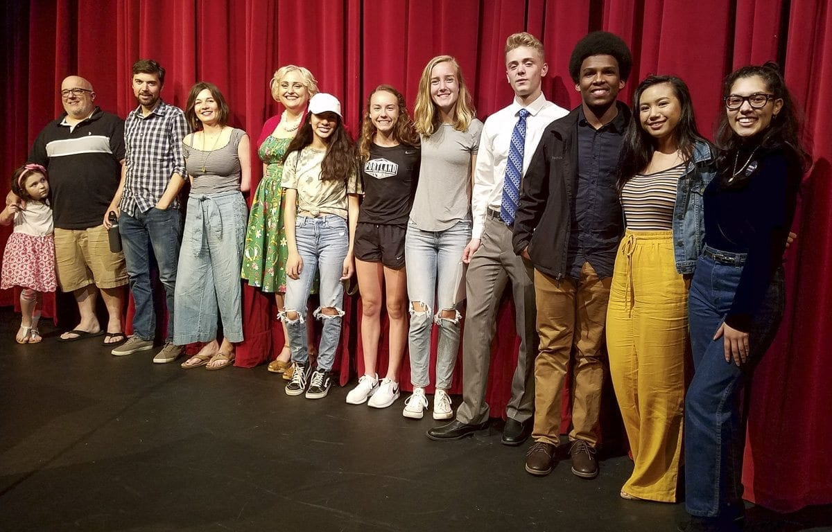 "Students, professional writers and a teacher were all one on stage Tuesday night at the first night of ""Orpheus,"" the annual reading event at Fort Vancouver High School. An author, an essayist, a Pulitzer Prize winner and eight students read from their works. Photo by Paul Valencia"