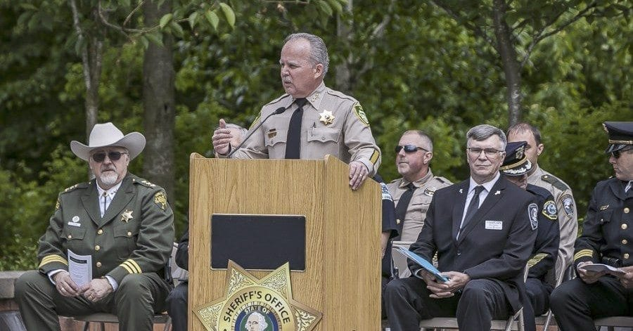 Clark County Sheriff Chuck Atkins served as Master of Ceremonies for the annual Clark County Law Enforcement Memorial Ceremony held last year in Vancouver. Photo by Mike Schultz