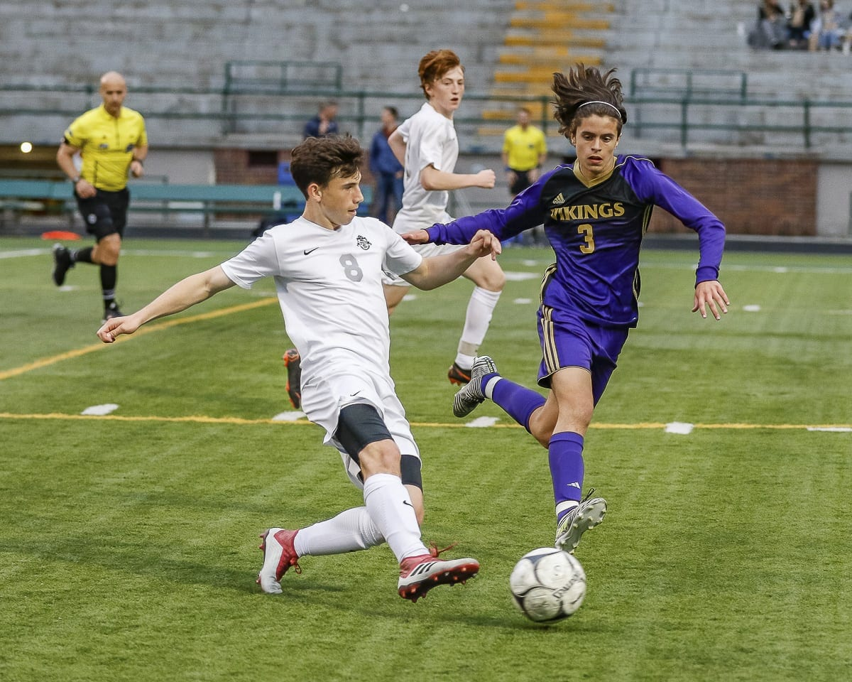 Skyview's Stephen Kiraly beats a Puyallup player to the ball during their Class 4A state playoff match Wednesday at Kiggins Bowl. Puyallup won 4-1. Photo by Mike Schultz