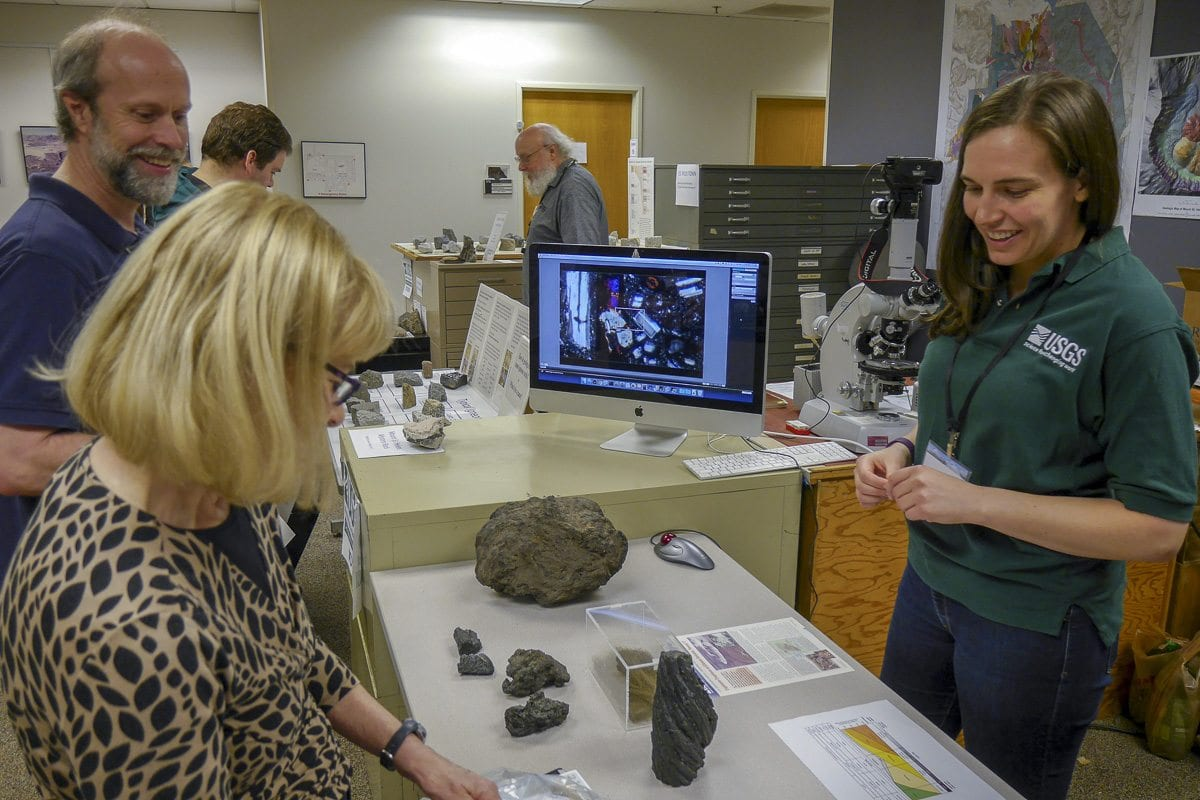 Clark County Councilor Jeanne Stewart shows off a rock she brought to the USGS Cascades Volcano Observatory open house in east Vancouver. Photo by Chris Brown