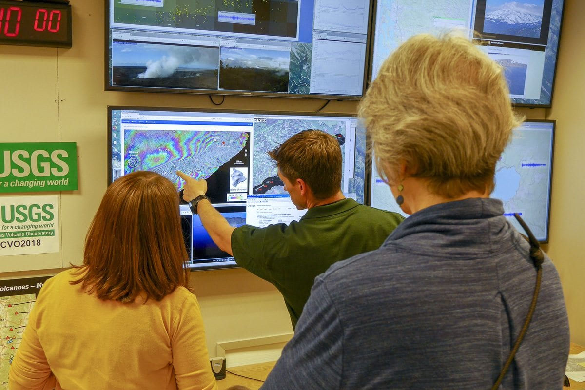 USGS Cascades Volcano Observatory seismologist Weston Thelen shows onlookers some of the data on the eruption in Hawaii. Photo by Chris Brown