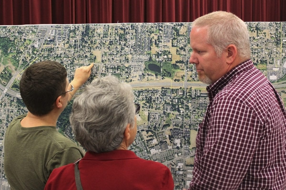 Attendees of a Thursday open house at Roosevelt Elementary ask questions of one of several WSDOT officials on hand to discuss three concepts for reducing crashes and congestion on State Route 500. Photo by Eric Schwartz