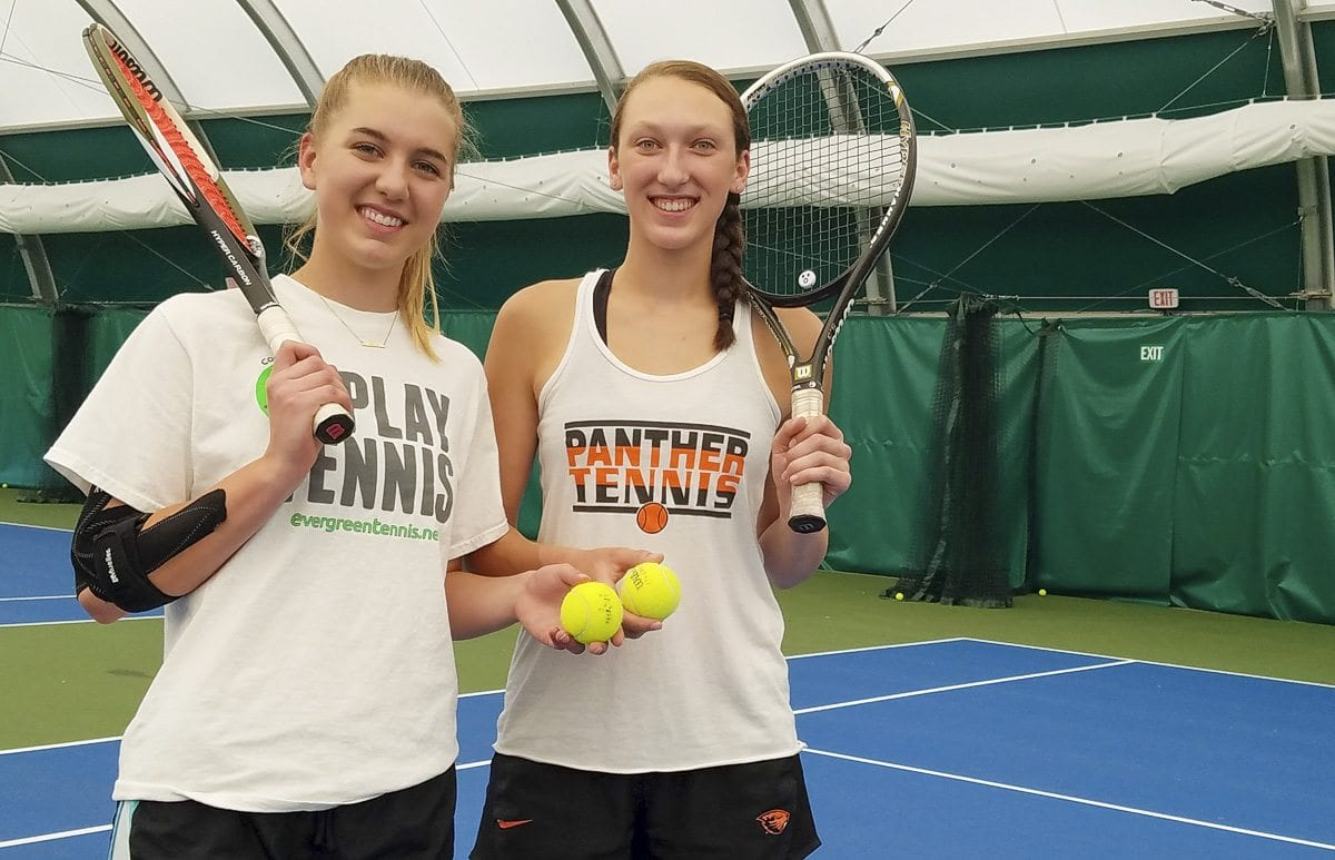 Washougal tennis players Rebecca Boylan (left) and Beyonce Bea won the Class 2A district doubles title last week and are heading to the state tournament in Seattle later this week. Photo by Paul Valencia