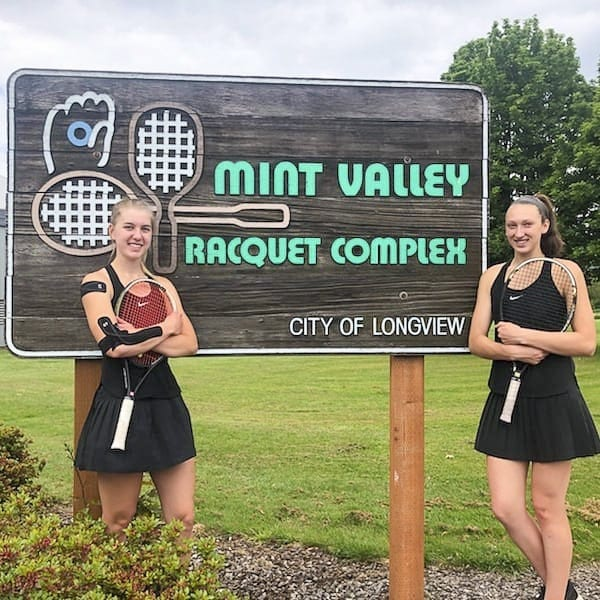 Senior Rebecca Boylan, left, and junior Beyonce Bea started playing tennis in 2016. Doubles partners from the beginning, they are now district champions and heading to state for the first time. Photo courtesy of Rebecca Boylan