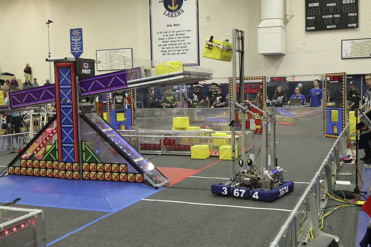 "The Cloverbots, with their 150-pound. robot nicknamed ""Cubert 8-bit,"" were selected to lead an alliance of four teams at the World Championship. Photo courtesy of Cloverbots robotics team"