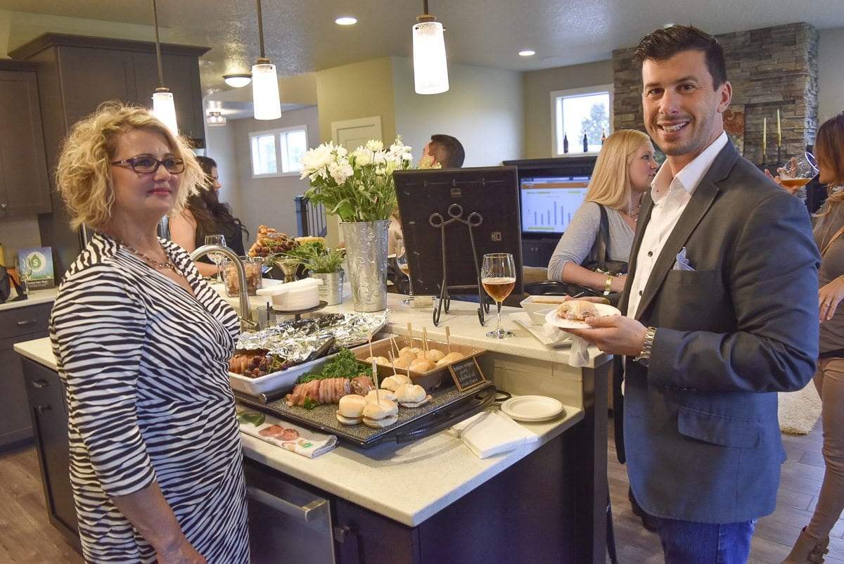 Deb Belden, owner of Farrar's Bistro and Sixth Avenue Bistro, shares her sliders with Will Amorin. Photo courtesy of BIA of Clark County