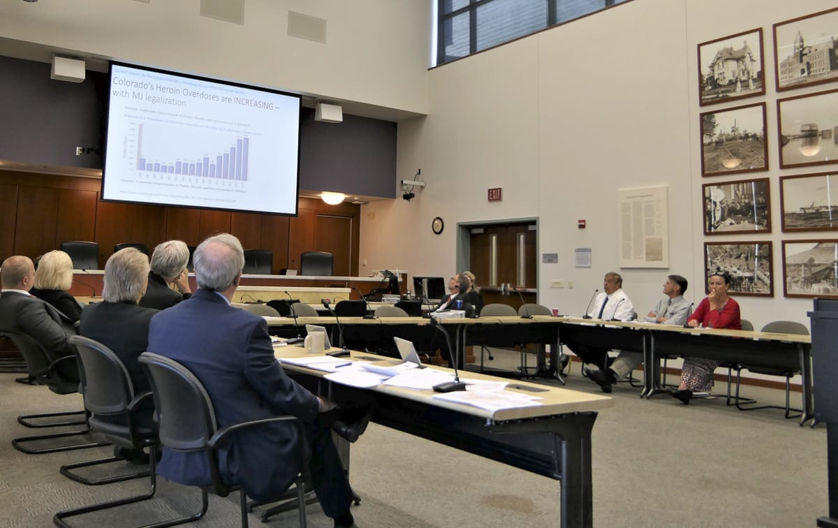 Attendees of Wednesday's work session look at data during a presentation on marijuana. Photo by Eric Schwartz