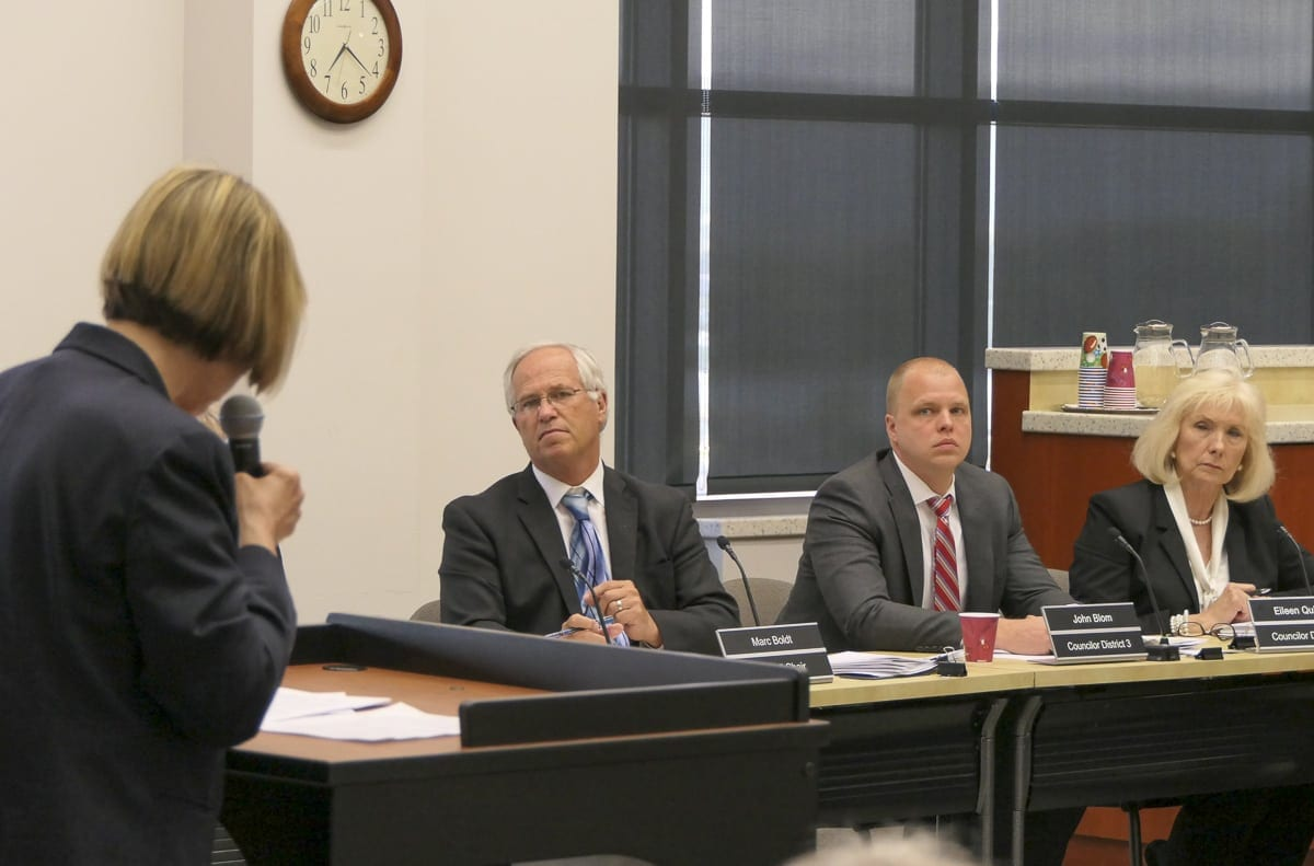 Council Chair Marc Boldt and councilors John Blom and Eileen Quiring listen to public testimony from Ann Donnelly during Wednesday's work session on marijuana. Photo by Eric Schwartz