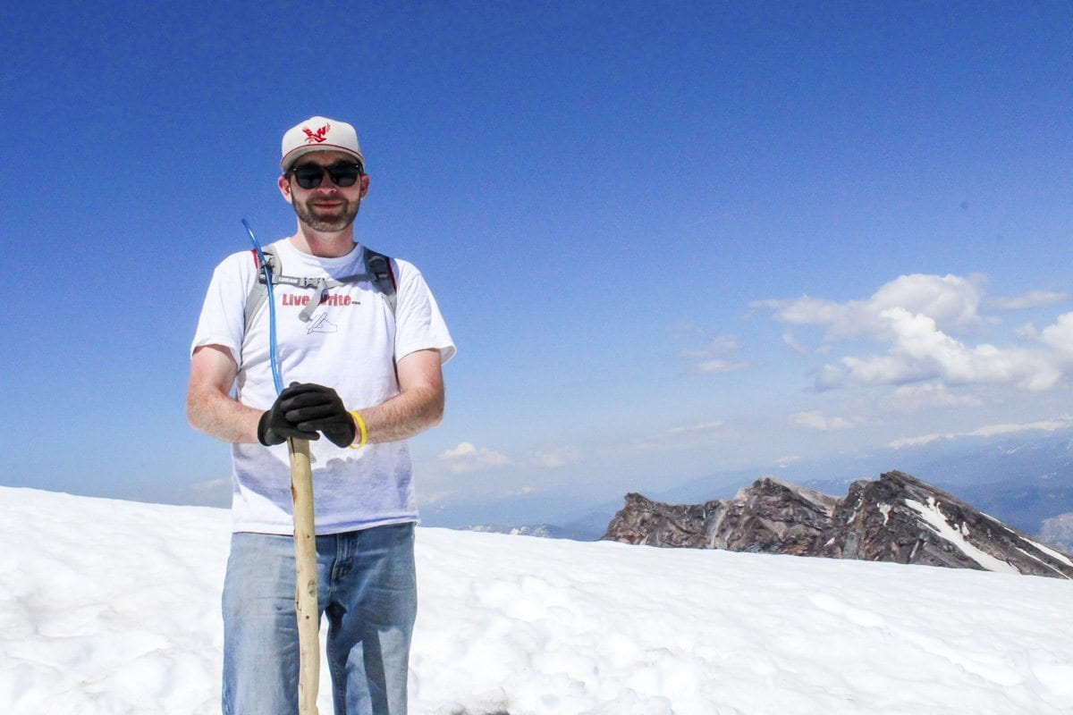 Reporter Eric Schwartz poses for a photo at the summit of Mount St. Helens. Photo by Eric Schwartz