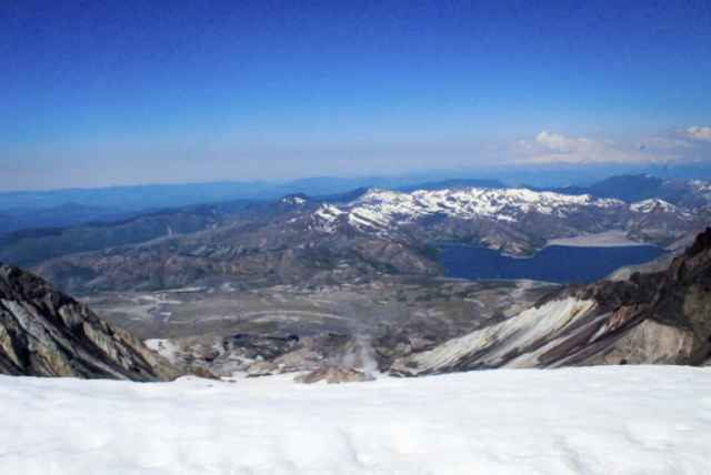Steam rises from the crater of Mount St. Helens as Spirit Lake is seen in the background at the summit of Mount St. Helens. Photo by Eric Schwartz