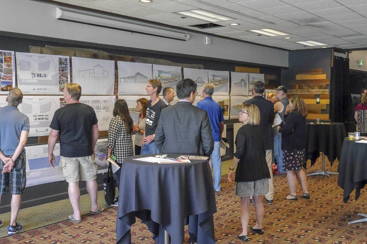 Members of the public check out three concept designs for the possible future of the Port of Vancouver's Terminal 1. Photo by Chris Brown