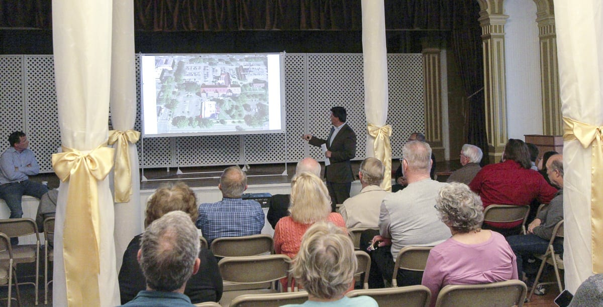 Attendees watch the May 31 presentation of The Historic Trust on Providence Academy. The image was provided by The Historic Trust