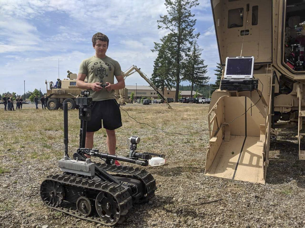 Chase Martin, of Vancouver, operates a robot from the 14th Engineering Battalion earlier this week at Joint Base Lewis-McChord. Several Army recruits got a tour of the installation. Martin is scheduled to report for training in August. Photo by Capt. Kenneth Wheeler, U.S. Army