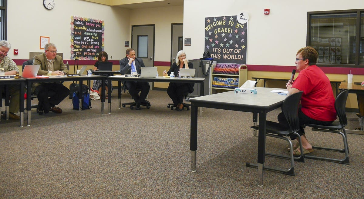 Superintendent Mark Ross and the Battle Ground School Board members hear from teachers at a meeting in May. Photo by Chris Brown