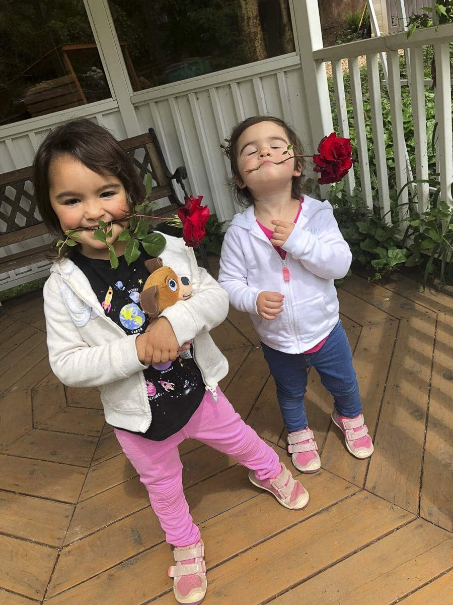 These young sisters enjoy picking the flowers, no matter where they are found. Photo by Heidi Wetzler