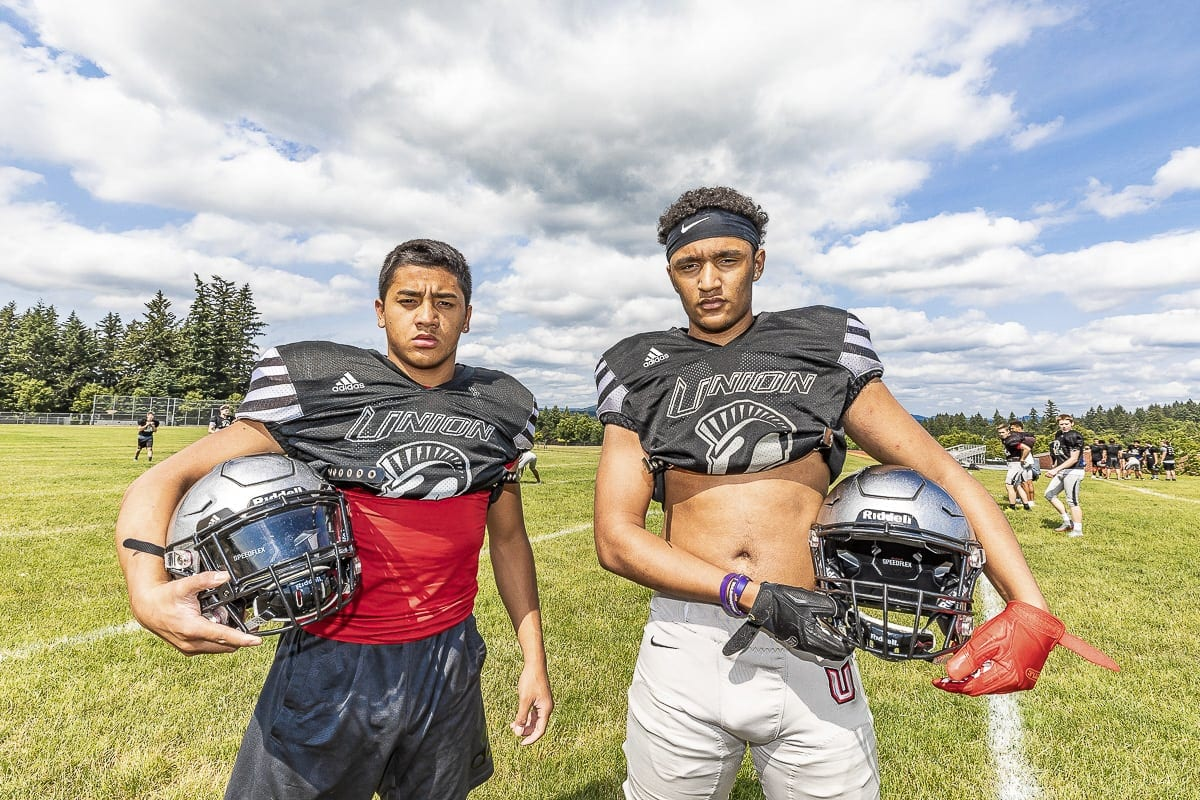 Lincoln Victor (left) and Darien Chase of Union football will make tough decisions when it comes to where they intend to play college football. Chase is one of the top recruits in Washington, and Victor is being recruited as a receiver even though he plays quarterback for the Titans. Photo by Mike Schultz