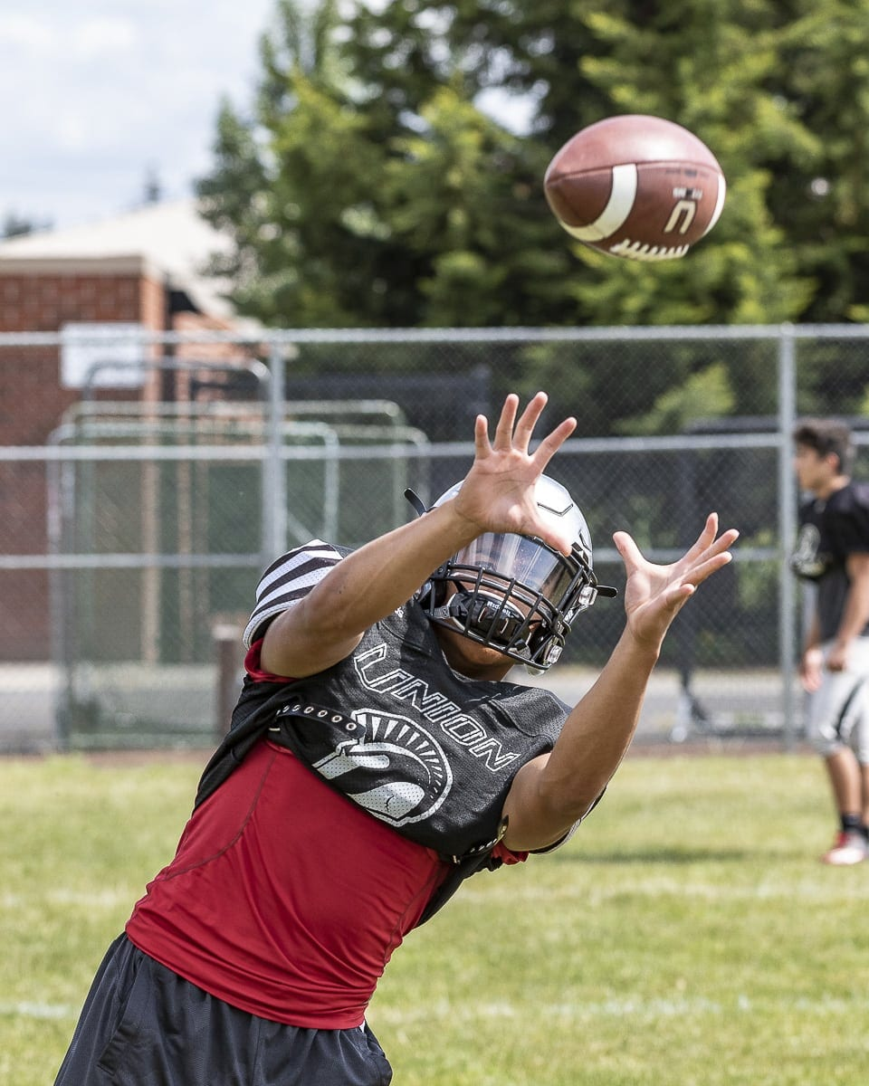 Lincoln Victor of Union does not get a chance to catch any passes in high school. He is the team's quarterback. In the offseason, though, he has become a top talent as a slot receiver in hopes of earning a college scholarship. Photo by Mike Schultz