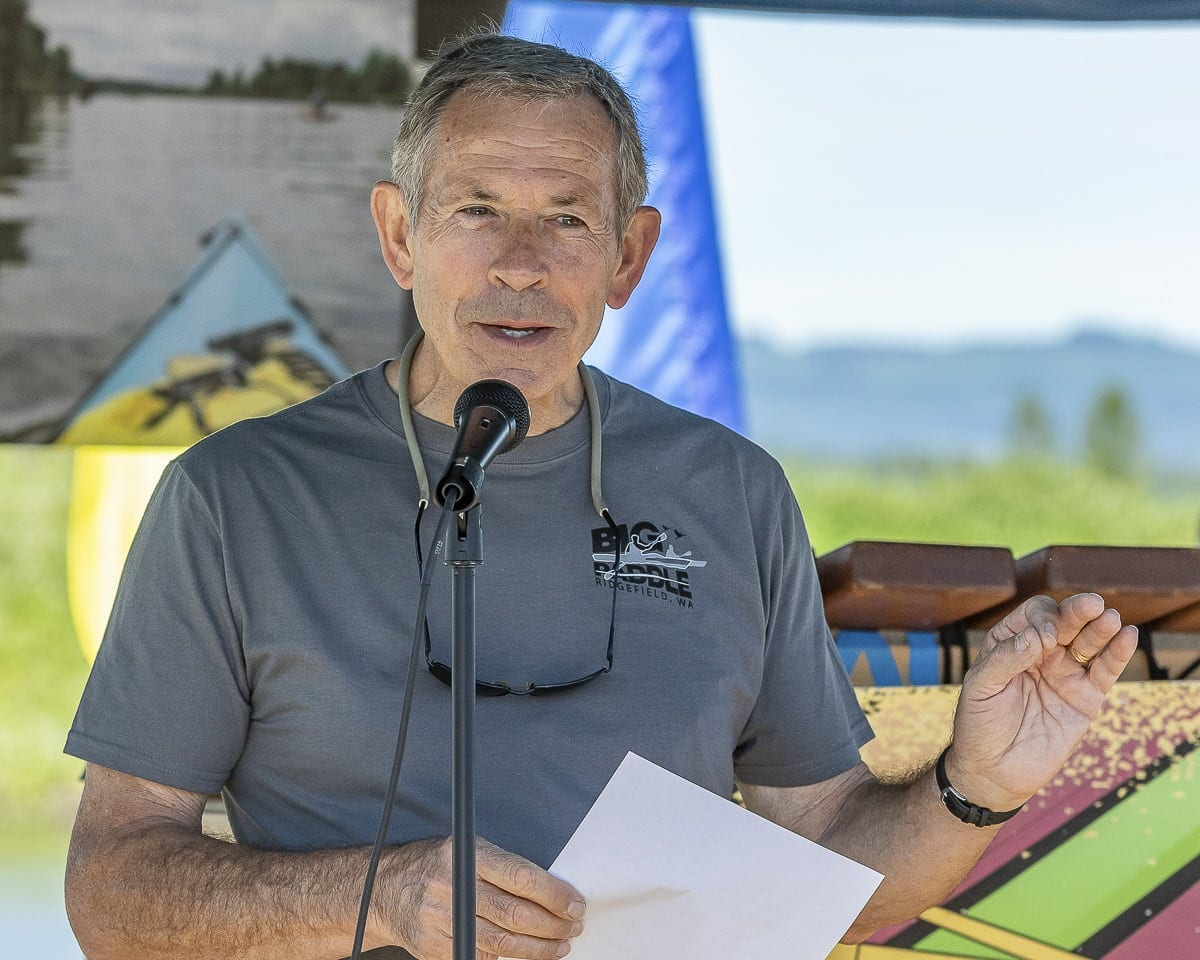 Ridgefield Mayor Don Stose speaks during the Ridgefield Big Paddle Saturday. Photo by Mike Schultz