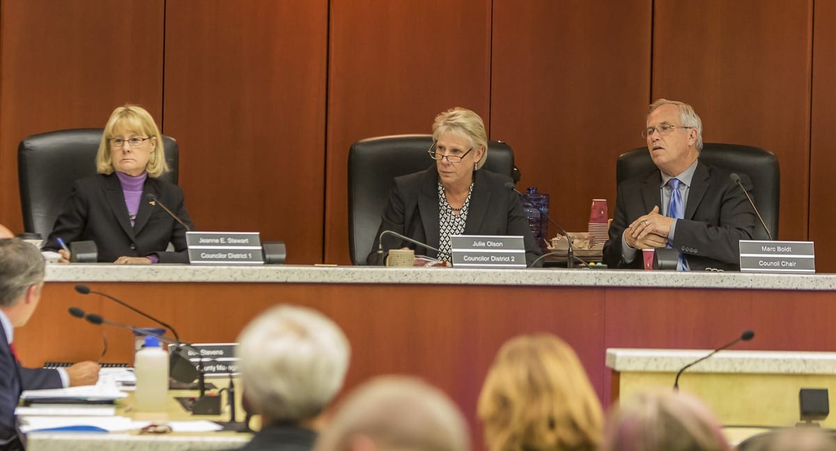 Clark County councilors Jeanne Stewart, Julie Olson, and Chair Marc Boldt are shown here in this file photo. Photo by Mike Schultz