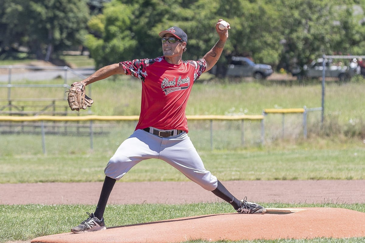 "Anthony ""Tony"" Davis, who has no feeling below his knees, learned to walk again and then learned to pitch again. The 36-year-old from Ridgefield plays for the Clark County Bombers in the Southwest Washington Adult Baseball League. Photo by Mike Schultz"