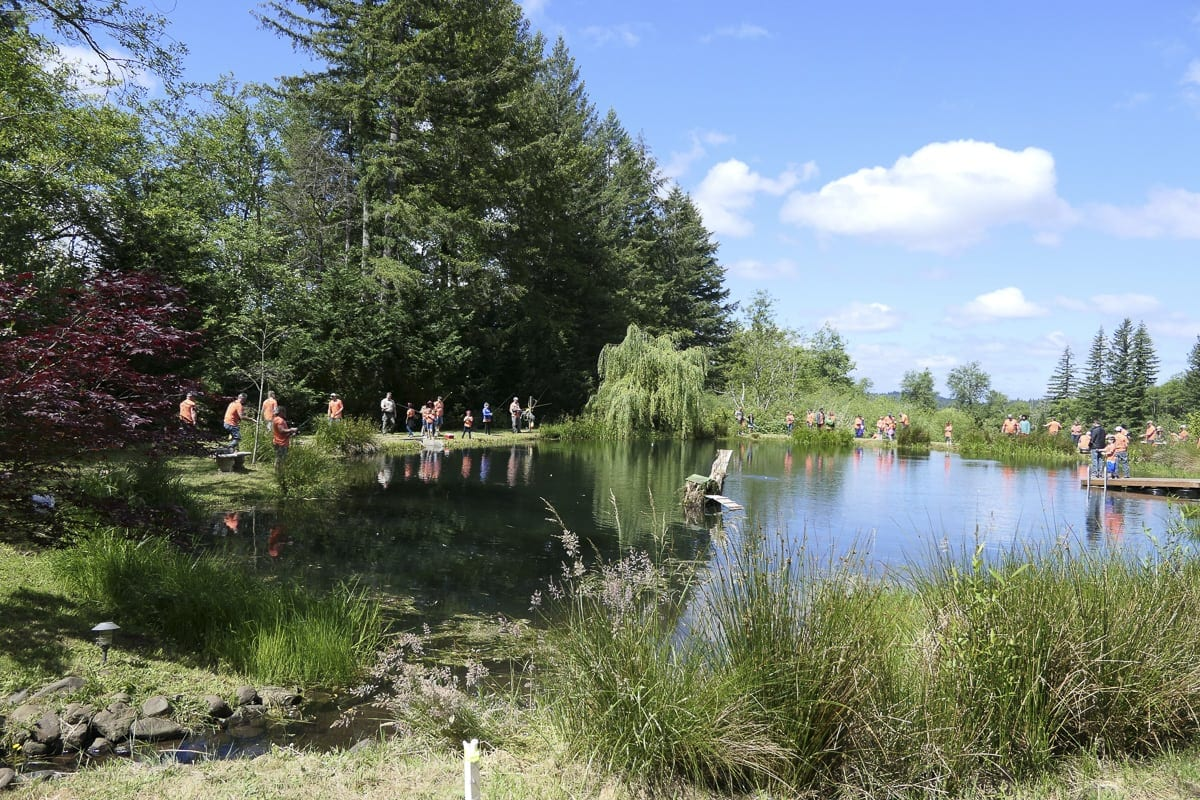 Dozens of people enjoy outdoor activities and mentorship at the third annual Trout Camp in Battle Ground. Photo by Chris Brown