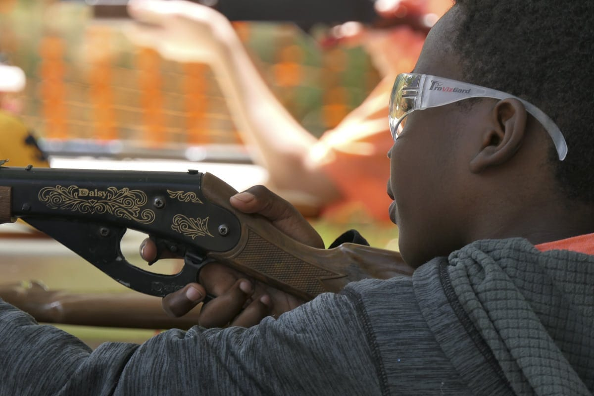 Children learn gun safety and shoot BB Guns at Trout Camp 2018 in Battle Ground. Photo by Chris Brown