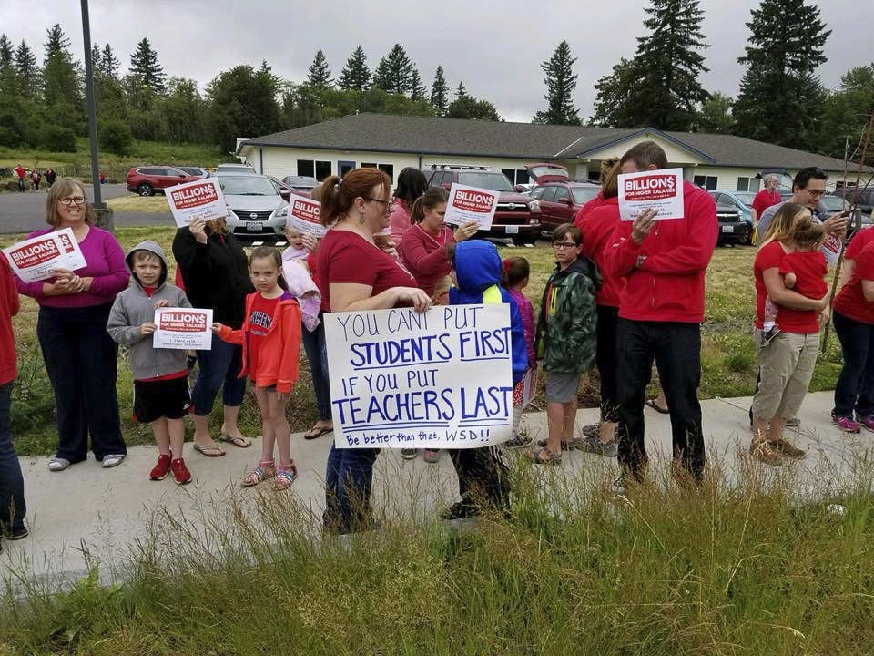 Teachers and parents hold signs at a rally to support higher wages for Washougal teachers. Photo courtesy Washougal Education Association