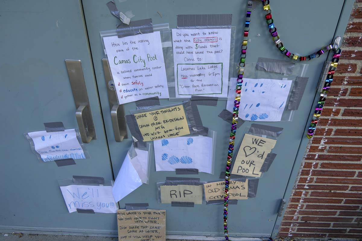 Signs mourning the loss of the Camas Municipal Pool mark the locked front doors. Photo by Chris Brown