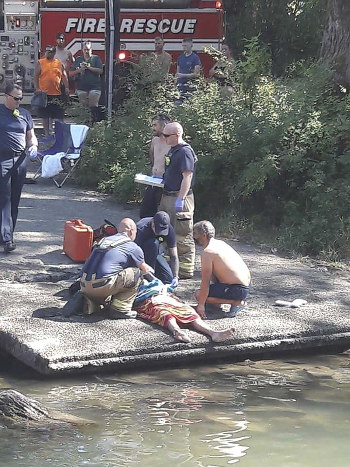 Clark County Fire & Rescue Paramedics tend to a teenage boy who nearly drowned Thursday at Daybreak Park in Battle Ground. Photo courtesy Elizabeth Dickey