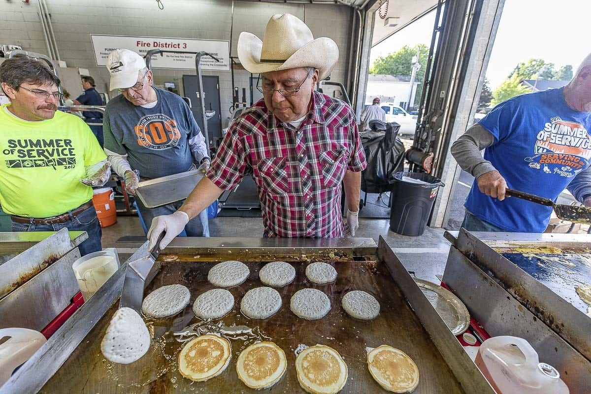 The pancake breakfast on July 21, hosted by Fire District 3, provided breakfast for festival-goers while raising money for two area burn-victims. Photo by Mike Schultz