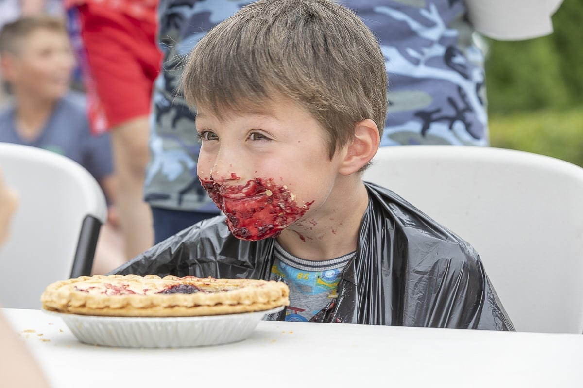 The rules for the annual pie-eating contest are simple; contestants receive a free pie and must eat as much as they can without using their hands. Photo by Mike Schultz