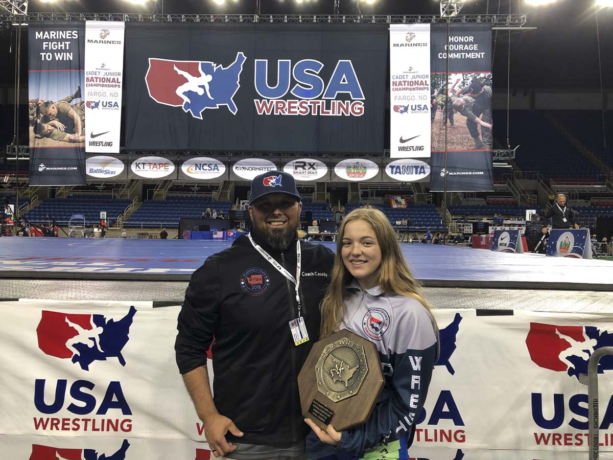 Nevaeh Cassidy shares a special moment with her dad and coach Nathan Cassidy after Nevaeh won a freestyle national title in Fargo, N.D. Photo courtesy of Nevaeh Cassidy