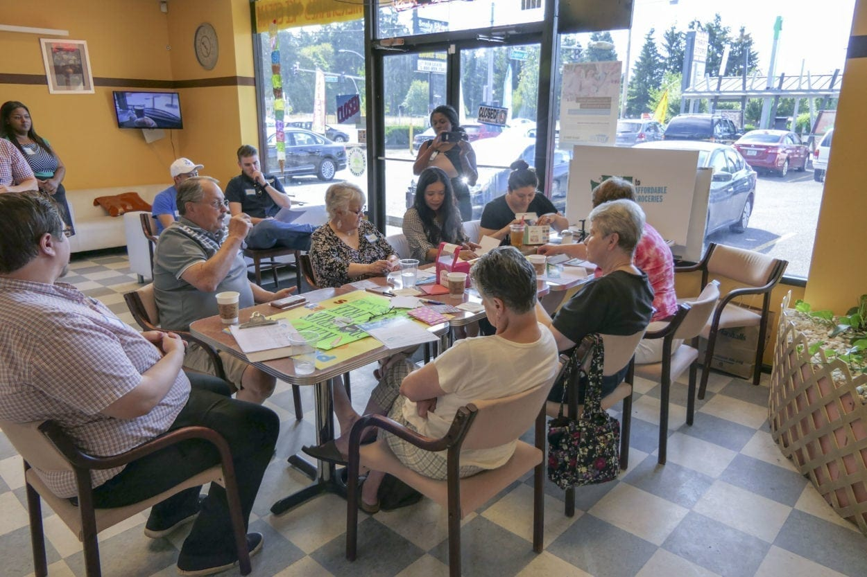 Vancouver business owners gather at Tonelli's Donuts & Cream on Fourth Plain to kick off the campaign for Initiative 1634, which would ban new taxes on sugary food or drinks. Photo by Chris Brown