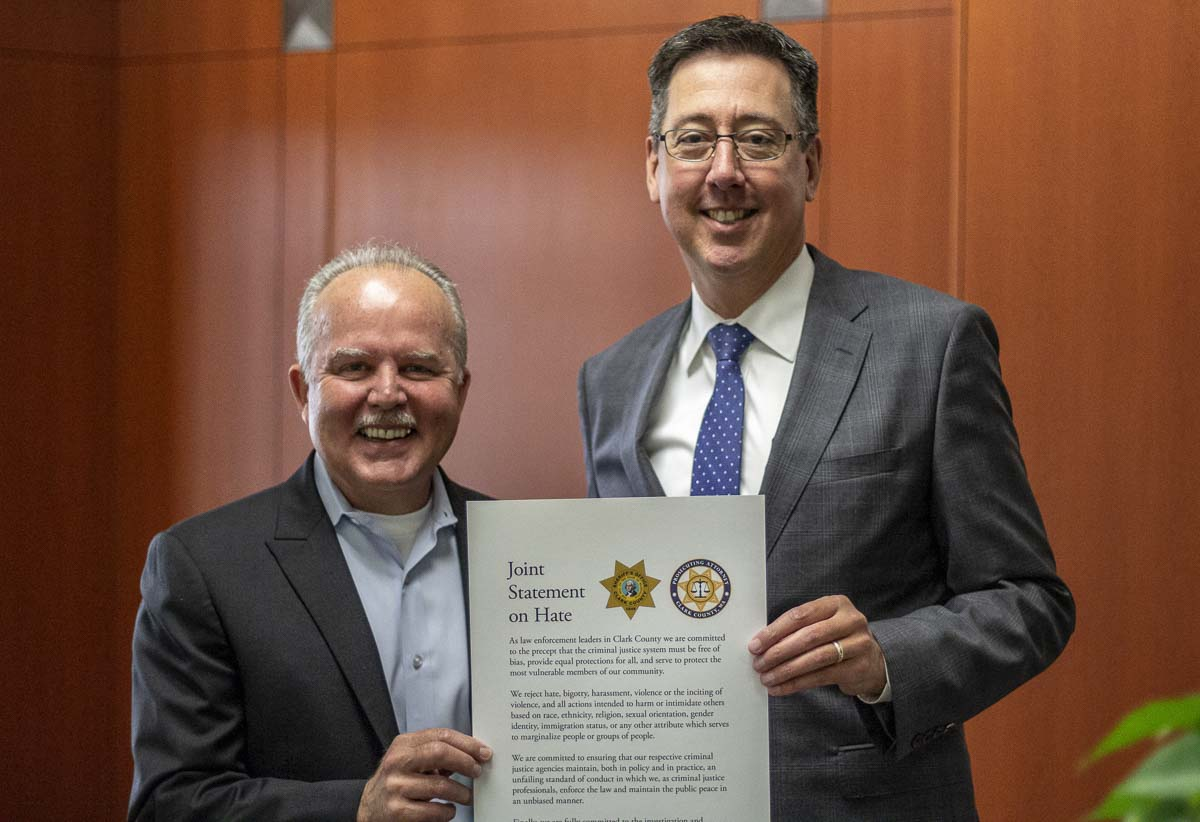 "Clark County Sheriff, Chuck Atkins (left), and Prosecuting Attorney Tony Golik, (right), pose with their ""Joint Statement on Hate"" at the Public Service Center in Vancouver on Aug. 29. Photo by Jacob Granneman"