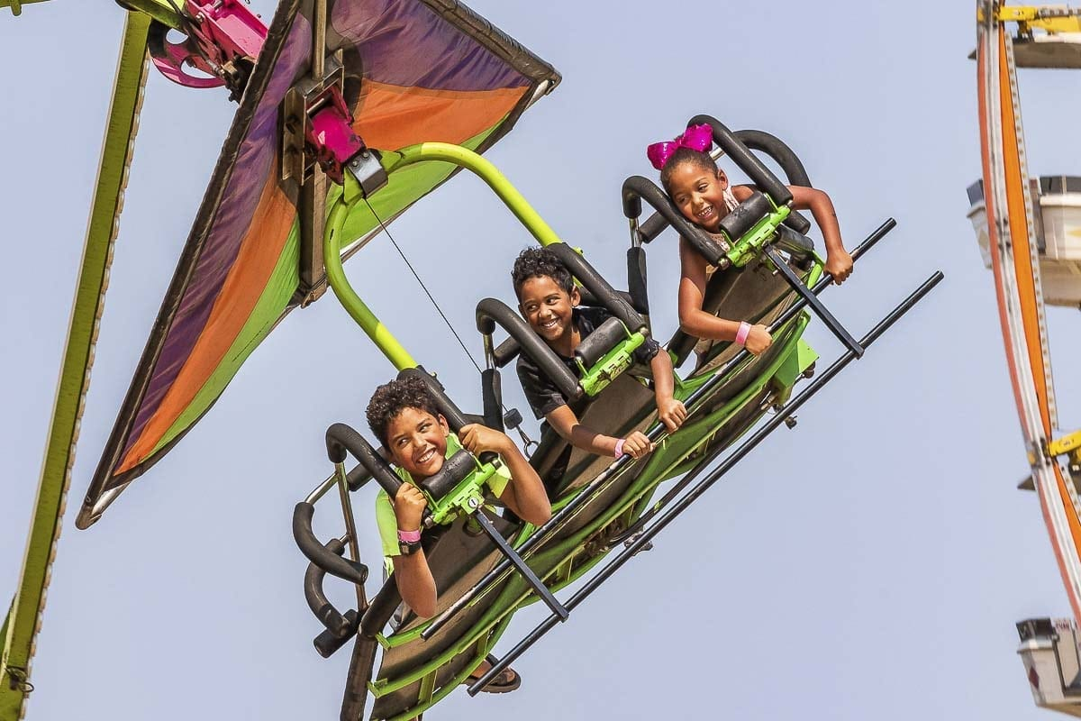 The carnival is always a popular element of the Clark County Fair. These youngsters seemed to be having a fun time Thursday. Photo by Mike Schultz