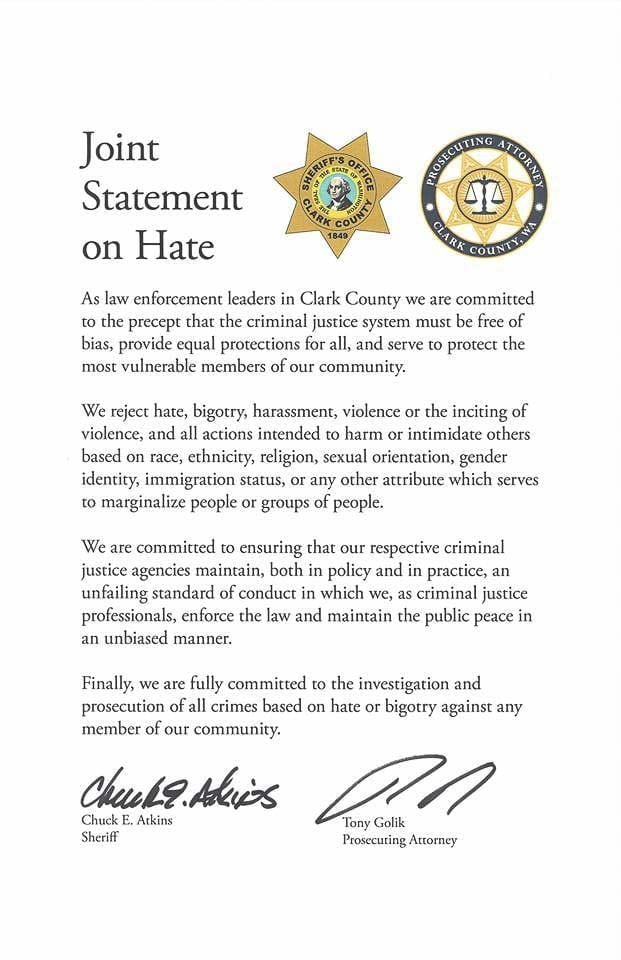 In light of ongoing hate-crime across the nation, Sheriff Chuck Atkins and Prosecuting Attorney Tony Golik sign agreement on issue.