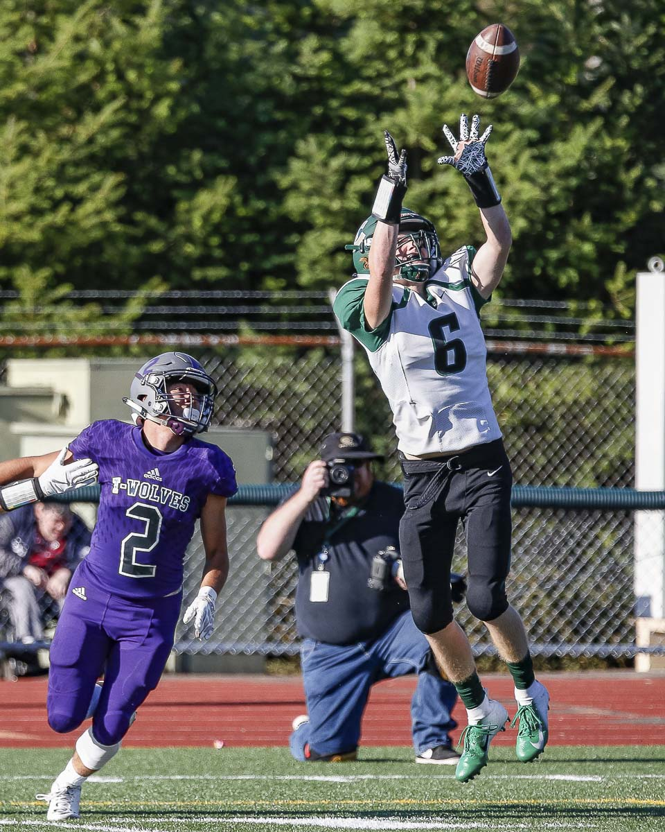 Evergreen defensive back Luke Allen (6) intercepts a Heritage pass in the second quarter of Friday's game at McKenzie Stadium. Photo by Mike Schultz
